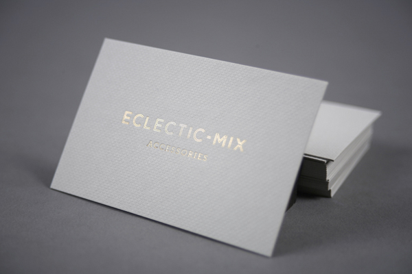 Business card with embossed surface and gold foil detail by Because Studio for fashion accessory label Eclectic-Mix
