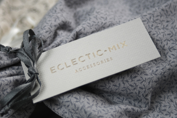 Tag with embossed surface and gold foil detail by Because Studio for fashion accessory label Eclectic-Mix