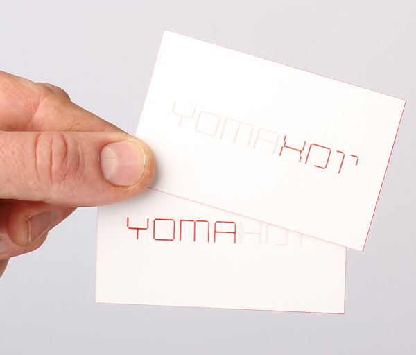Logo and debossed business card with red edge painted detail designed by Kobi Benezri for Jerusalem-based architecture practice Yoma