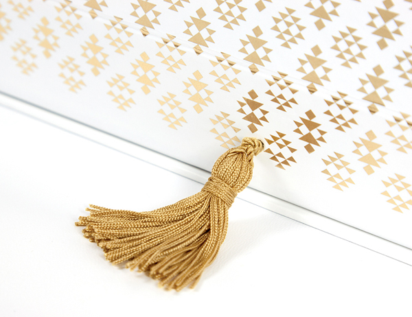 Packaging with gold foil detail designed by Rocío Martinavarro for textile producer Zeri Crafts