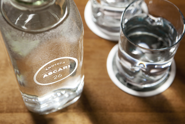 Logo as a glass bottle detail designed by Blok for Toronto based Italian restaurant Ascari Enoteca