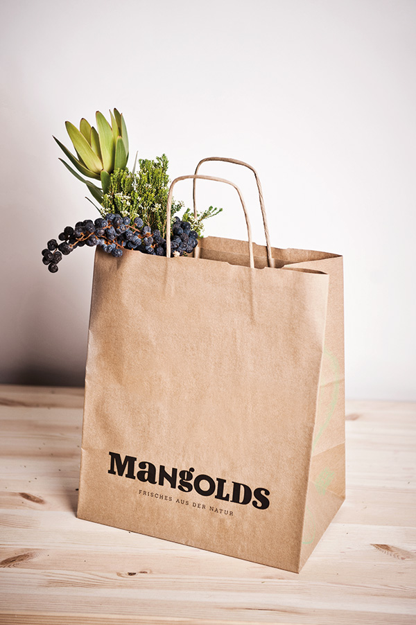Paper shopping bag with logotype detail designed by Moodley for Austrian vegetarian and wholefood restaurant Mangolds