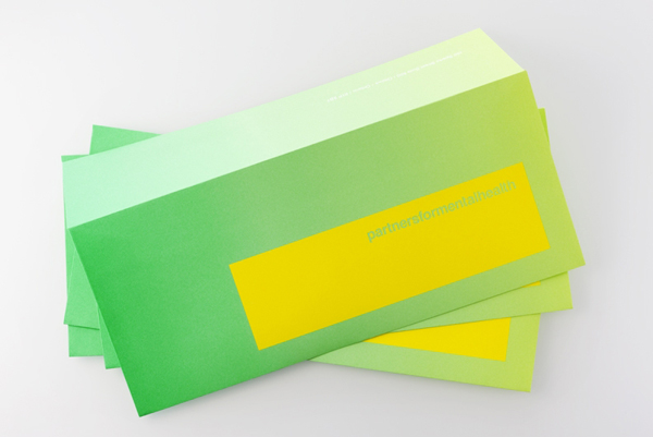 Logo and envelopes with fluorescent yellow and green print treatment created by Blok for Canadian charity Partners For Mental Health