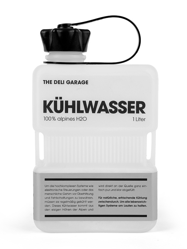 Packaging with screen print and silver label detail designed by Rocket & Wink for The Deli Garage's premium glacial water product Kühlwasser
