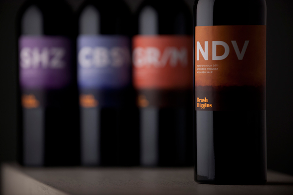Packaging with watercolour illustrative detail and orange foil print finish designed by Swear Words for wine label Brash Higgins