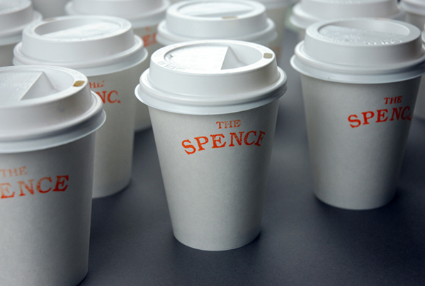 Logo and coffee cups designed by Joe Hinder working at Hike Design for cafe bakery The Spence