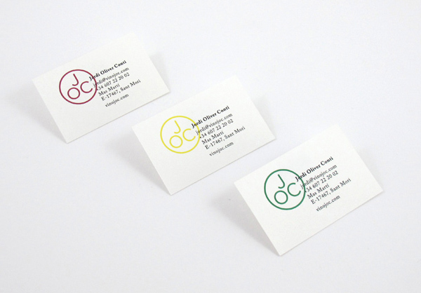 Monogram and business card designed by Francesc Moret for wine range Jordi Oliver Conti
