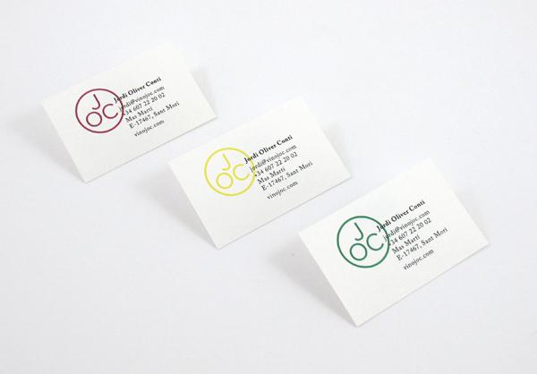 Monogram and business card designed by Francesc Moret for wine range Jordi Oliver Conti