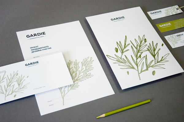 Logo and stationery with hand drawn coloured pencil plant illustrations by Paradox Box for landscaping business Gardie
