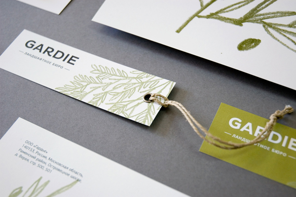 Logo, tag and stationery with hand drawn coloured pencil plant illustrations by Paradox Box for landscaping business Gardie