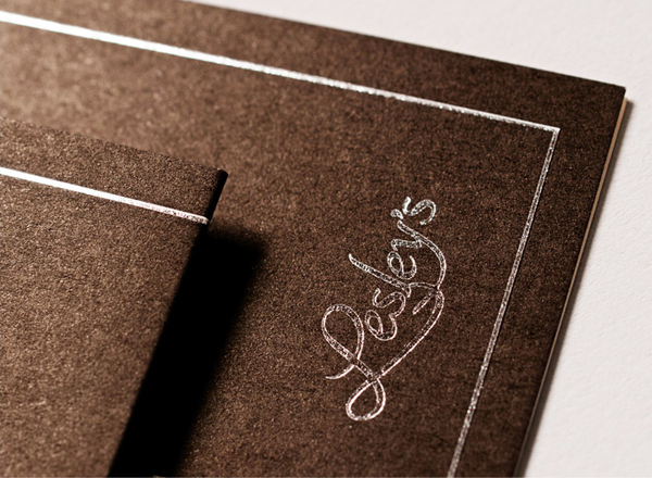 Logo and stationery with silver foil and black paper detail designed by YUI Studio for US based confectioner Lesley's Gourmet