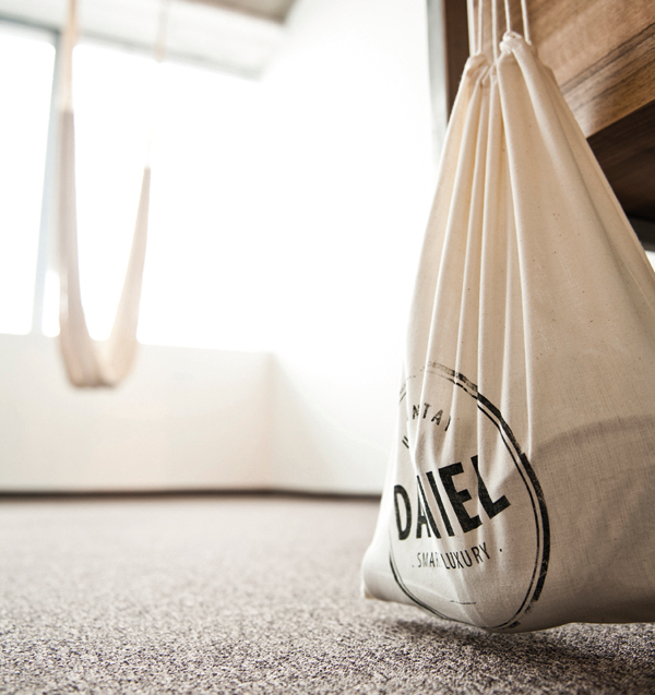 Draw string bag with screen printed logo detail designed by Moodley for Vienna and Graz based luxury hotel Daniel