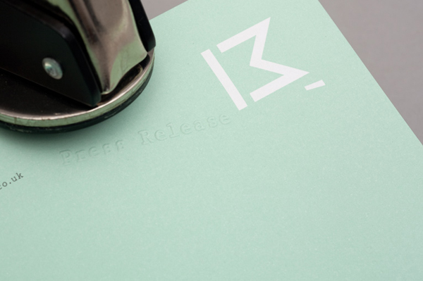 Logo and stationery with emboss detail designed by This Is Studio for specialist music industry PR firm Macbeth Media Relations