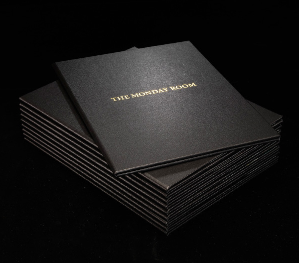 Logo and gold deboss leather menu cover for cafe wine bar The Monday Room designed by Strategy