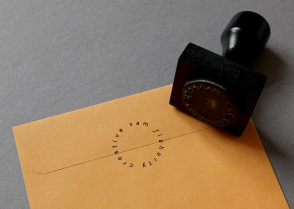 Logo and manilla envelope with stamp detail designed by Sydney based freelance graphic designer and art director Sam Flaherty