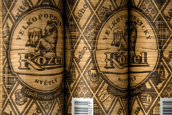 Packaging with heat treated wood effect and regional illustrations designed by Yurko Gutsulyak for Czech brewer Velkopopovický Kozel