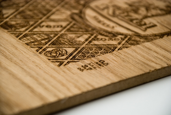 Heat treated wood panel with regional illustrations designed by Yurko Gutsulyak for Czech brewer Velkopopovický Kozel