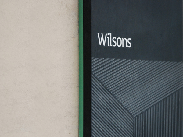 Logo and signage with etched detail by MyttonWilliams for legal advice firm Wilsons