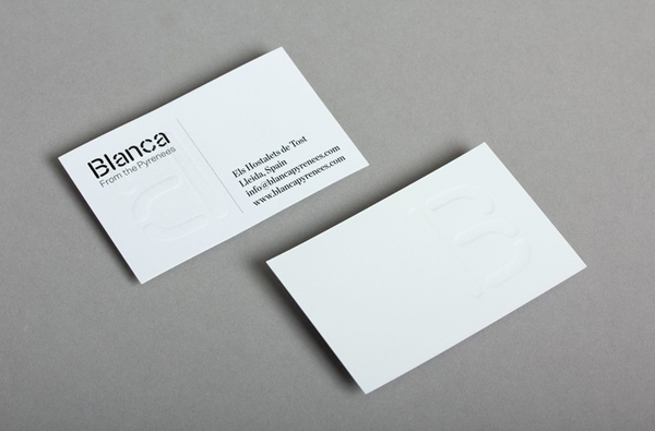 Logo and business card with blind emboss detail for dairy hub Blanca designed by Lo Siento