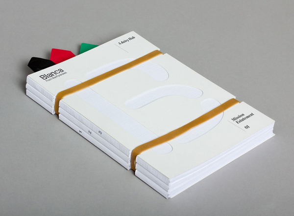 Brochure with rubber band, bookmarks and die cut details designed by Lo Siento for dairy hub Blanca