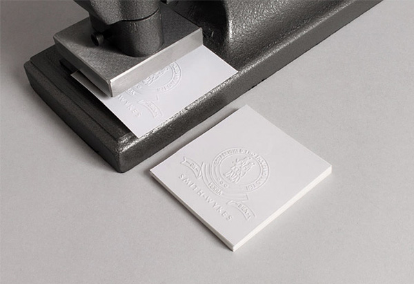 Blind embossed logo for London and Paris-based male fashion brand Smith-Wykes designed by Studio Small