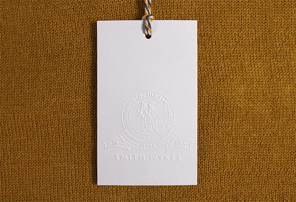 Blind embossed clothing tag for London and Paris-based male fashion brand Smith-Wykes designed by Studio Small