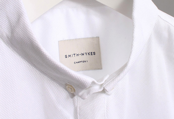 Stitched logo and clothing label for London and Paris-based male fashion brand Smith-Wykes designed by Studio Small