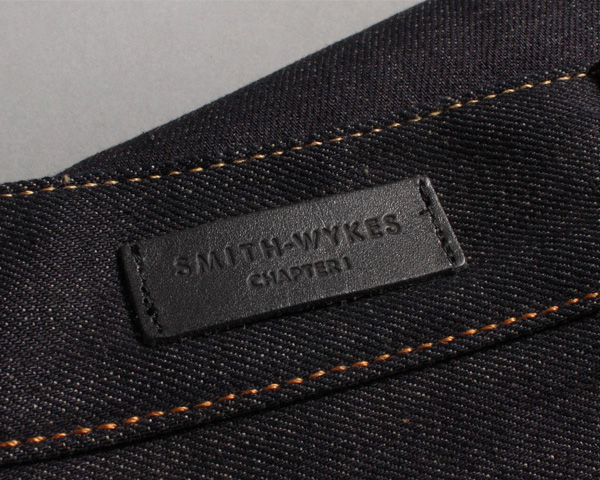 Logo and stitched leather clothing label for London and Paris-based male fashion brand Smith-Wykes designed by Studio Small