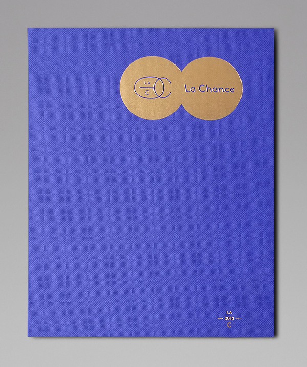 Logo and print with gold foil and blue embossed surface treatment for furniture and lighting company La Chance designed by Artworklove