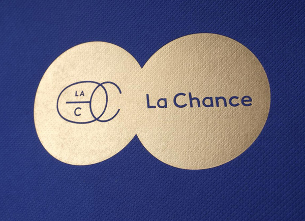 Gold foil logo across a blue embossed surface treatment for furniture and lighting company La Chance designed by Artworklove