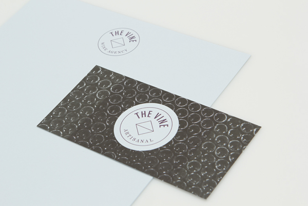 Logo, business card and letterhead for Italian and Californian wine specialist The Vine created by Blok