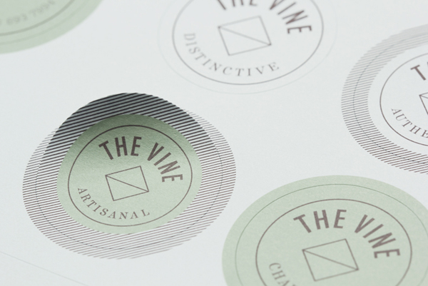 Logo and stickers for Italian and Californian wine specialist The Vine designed by Blok