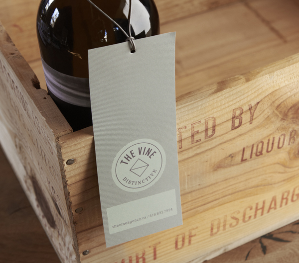 Logo and labels for Italian and Californian wine specialist The Vine designed by Blok
