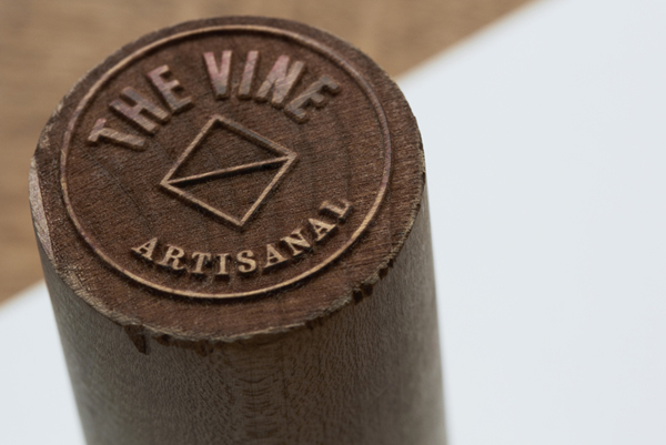 Logo and stamp for Italian and Californian wine specialist The Vine designed by Blok