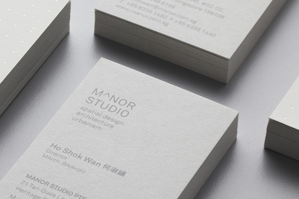 Logo and business card for Singapore-based architectural and spatial design practice Manor Studio created by Manic