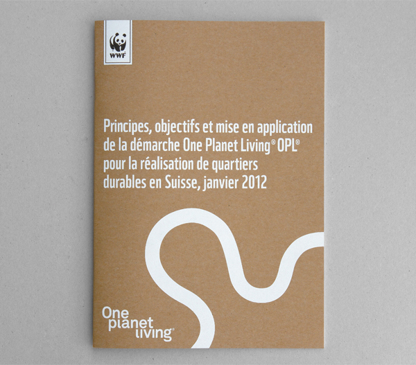 Printed collateral featuring white ink on unbleached substrate for One Planet Living designed by Demian Conrad