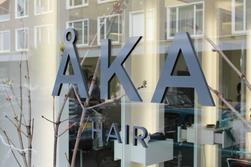 Logo and signage designed by DC for hair salon ÅKA