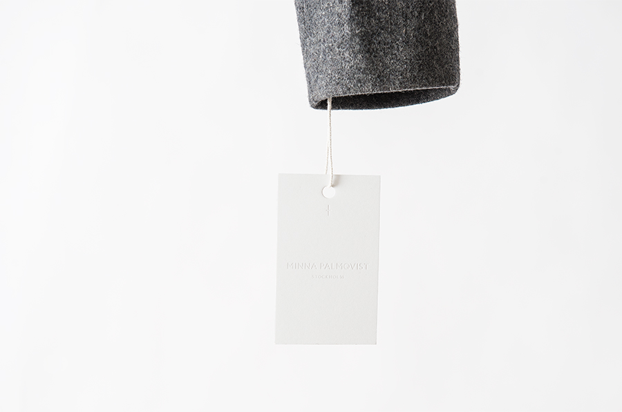 Logotype, mark and blind debossed tag designed by Bedow for fashion designer and label Minna Palmqvist