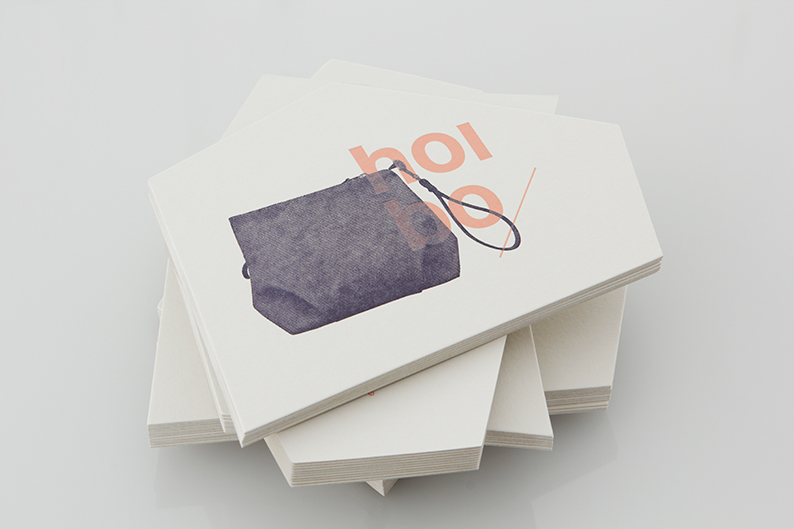 Logo and print with angular die cut detail designed by Blok for luxury bag, clothing and accessories brand Hoi Bo