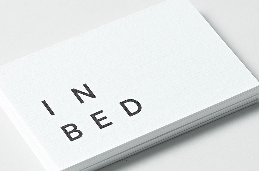 Logo and business card with laid paper detail for linen online retailer In Bed designed by Moffitt.Moffitt