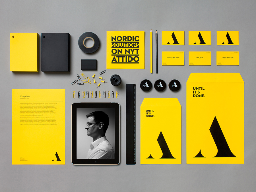 Logo and stationery with a yellow and black colour palette designed by Bond for Finnish information system development and optimisation company Attido
