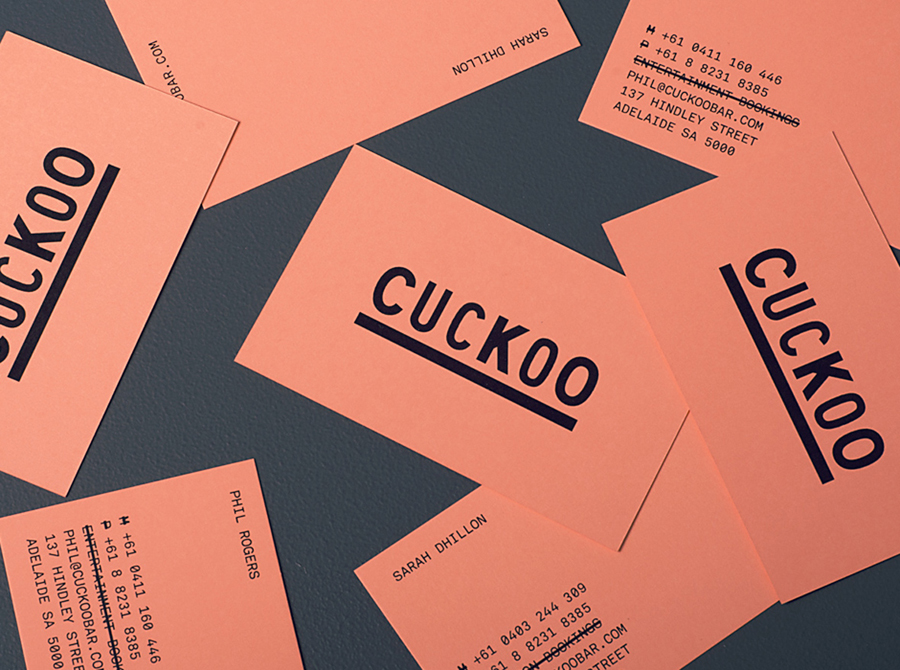 Logo and salmon pink business card designed by Band for underground electronic music venue, cocktail and tapas bar Cuckoo