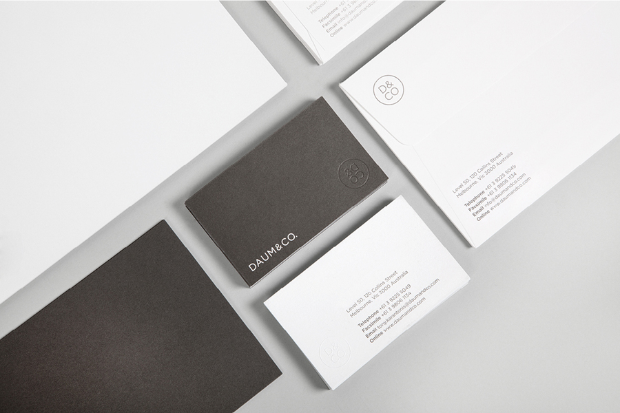 Logo and blind embossed business card designed by Hunt Studio for business advisory and management consultancy Daum & Co