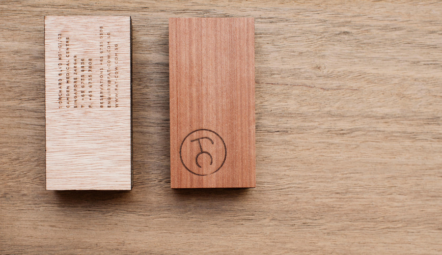 Logo and wood business card with heat stamp treatment for specialist beef restaurant Fat Cow designed by Foreign Policy