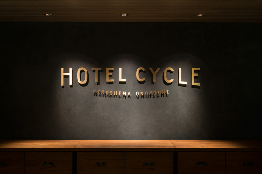 Logotype and interior signage designed by UMA for U2's Onomichi based Hotel Cycle