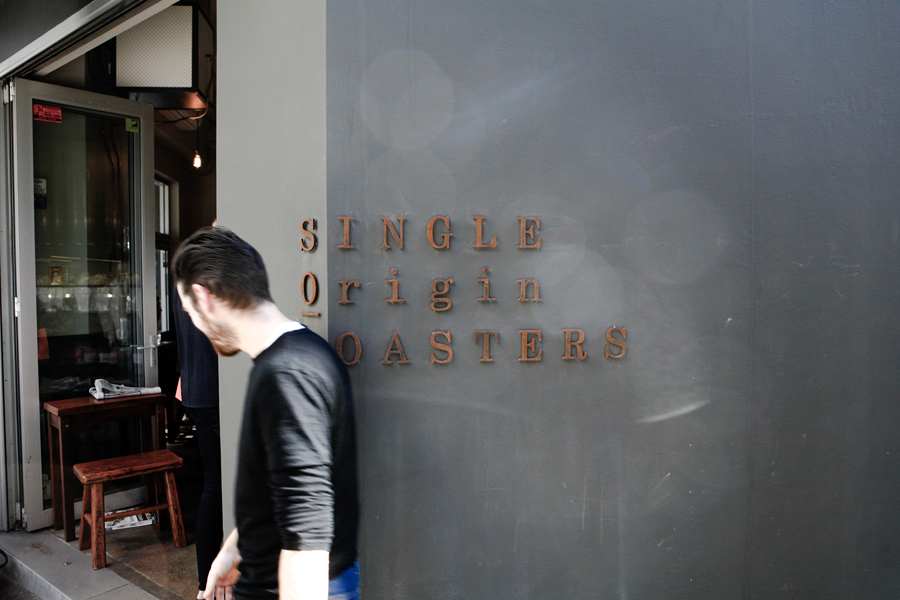 Weathered exterior signage for Single Origin Roasters designed by Maud