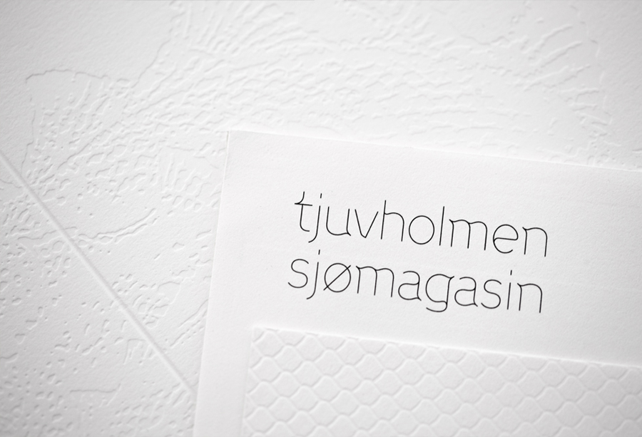 Logo and print with blind debossed illustrative detail designed by Work In Progress for Norwegian seafood restaurant Tjuvholmen Sjømagasin