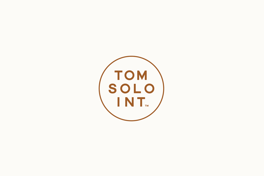 Logo for photographer Tom Solo designed by Mash
