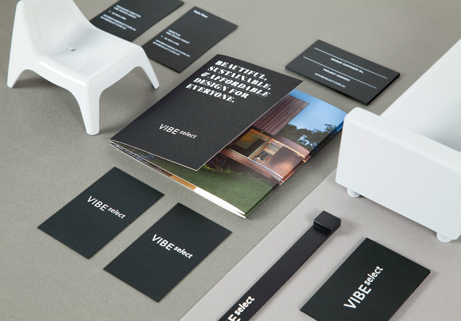 Sans-serif logotype, brochure and white ink and black board business card for architectural firm Vibe Select designed by Studio Constantine