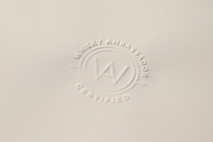 Blind embossed logo designed by O Street for Whisky Ambassador